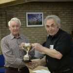 2018 Club Champion Norman receiving the trophy from John Ingamells.